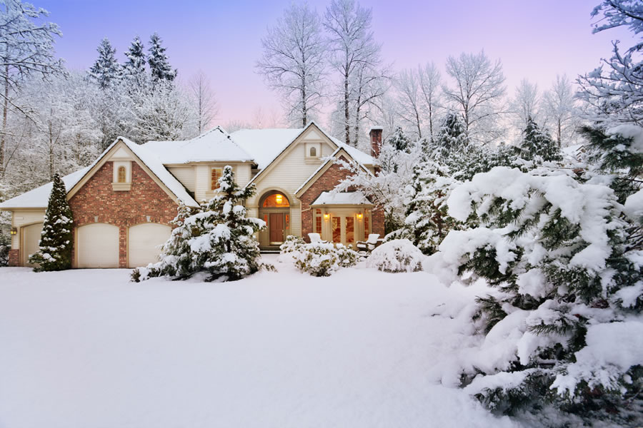 Picture of beautiful home with snow