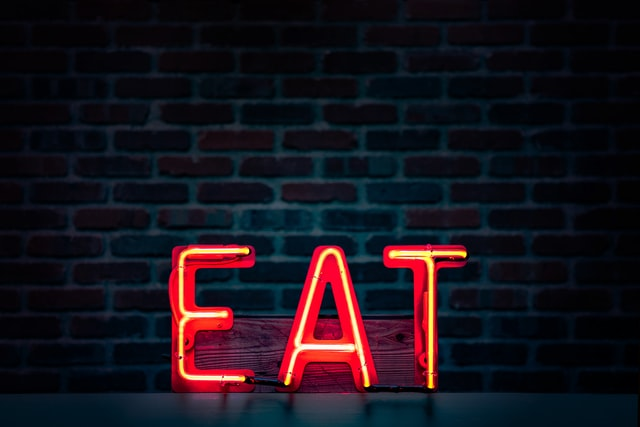 neon sign that reads 'eat'